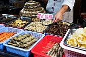 Maggots at a market (Lijiang, China)