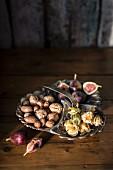 Mixed nuts, kumquats and fresh figs
