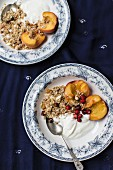 Yoghurt, cereals and peaches with wild strawberries