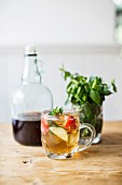 Pimms with strawberries and mint