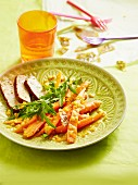 A carrot medley with ginger and chilli served with tofu slices and rocket