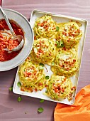 Spaghetti nests with tomato sauce