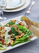 Caesar salad with chicken strips