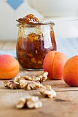A jar of apricot and nectarine jam with walnuts