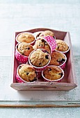 Blueberry muffins with brown sugar on a wooden tray