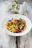 Fusilli with chicken and red onions