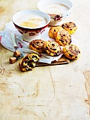 Cinnamon buns with chocolate almonds and two cups of cafe latte