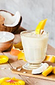 A mango and coconut smoothie with yoghurt
