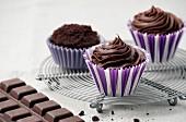 Chocolate ganache cupcakes on a wire rack