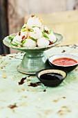 Stuffed tapioca dumplings with dips (Thailand)