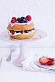 A croissant-doughnut with marshmallow cream and berries