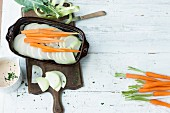 Kohlrabi gratin with carrots being made