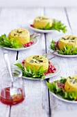 Ground elder flans with pomegranate seeds