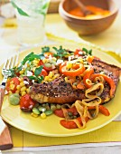 Pork chop with a sweetcorn salad and peppers