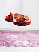 Stone fruit compote in stemmed glasses