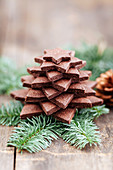 A Christmas tree made of chocolate biscuits on a pine sprig