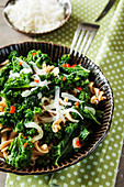 Spelt wholemeal pasta with green kale, chilli pepper, garlic, onion and Parmesan