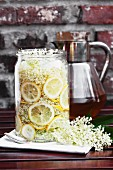 Homemade elderflower syrup in a large jar