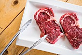 Two raw beef steaks