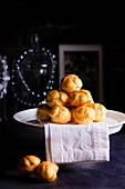 A pile of profiteroles on a cake stand