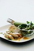 Chicken breast with gravy and a garden salad