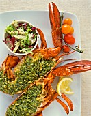 Lobster with a herb filling and salad