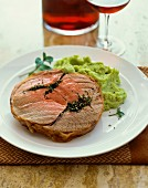 Roast pork with a herb filled and mushy peas