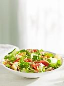 An oriental salad with cucumber, grapefruit and coriander