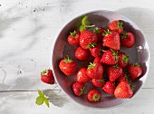 Strawberries in a metal bowl, seen from above