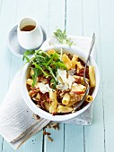 Rigatoni gratin with rocket and pine nuts