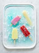 Various ice lollies on ice
