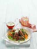 Lamb kofta on a bed of tabbouleh