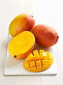 Mangos, whole and sliced