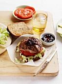 A minute steak, tomato and salad sandwich