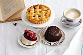 Various different cakes with a cup of coffee