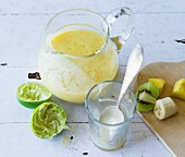A pineapple and kiwi smoothie made with banana and lime juice