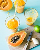 Tropical smoothies made with papaya, melon, banana and lemongrass