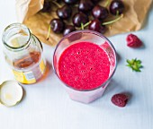 An almond milk smoothie made with cherries, berries and agave syrup