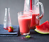 A smoothie made with melon, strawberries and alcohol free bitters
