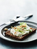 Wholemeal bread topped with goat's cheese and vegetable cream