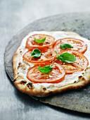 Goat's cream cheese and tomato pizza