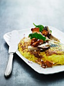 An omelette with goat's cheese and mushroom salad