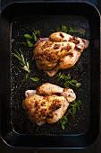 Spiced chickens in a roasting tin