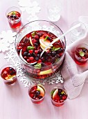 Apple punch with raspberries, blueberries and cranberries