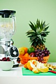 A blender and fresh fruits