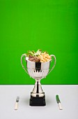 Beef with French fries in a trophy