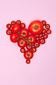 Various tomatoes arranged in the shape of a heart