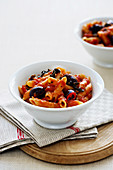 Penne Puttanesca with tomatoes, anchovies and olives