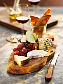 Assorted Cheese with Grapes on Bamboo Board