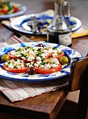 Tomato salad with goats cheese and olives (Spain)